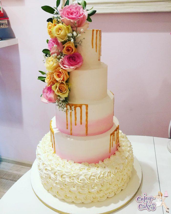Pink blush goldendripp wedding cake