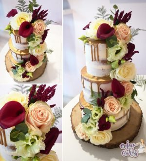 Semi-naked wedding cake with flowers