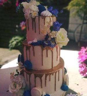 Blue gold drip wedding cake