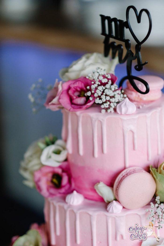 Pink creme dripp wedding cake