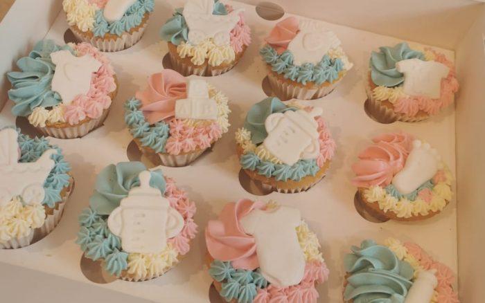Gender reveal baby cupcakes